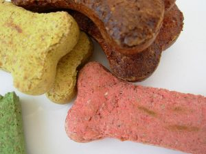 Give your pup treats and praise when they go potty where they are supposed to. TiresAndTails.com