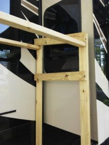 Wood frame around fifth wheel slide-out window
